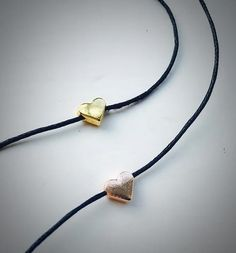 The heart charm quite simply symbolises any type of love: Self-love, family, platonic, romantic and unconditional.  Gold Plated heart bead on a delicate waxed cotton necklace measuring 13 long with a gold plated extension chain to fit any neck size. Please select which colour cotton you would like your choker on.  I also do this choker in Rose Gold: https://www.etsy.com/uk/listing/471908941/rose-gold-plated-heart-choker-heart?ref=listings_manager_grid  Jewel...