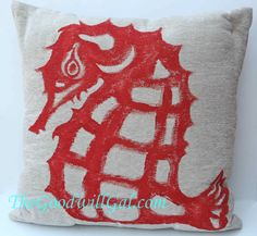 I added a bit of the #sea to my #summer decor by painting a sea horse on a pillow from #Goodwill. $3.99 #Nautical