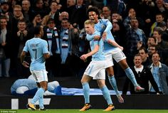 De Bruyne is congratulated by team-mates Leroy Sane and Sterling after providing the assist for Jesus' strike