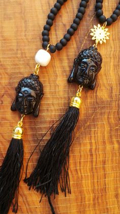 Long beaded buddha tassel necklace.