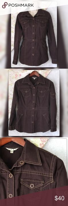"""CAbi M Halftime Safari Snap Front Denim Jacket CAbi M Halftime Safari Snap Front Denim Jacket. 98% Cotton 29% Spandex Raisin Color Pit to pit measures 20"""" Length 29"""" Sleeves 25"""" Gently Used with no flaws CAbi Jackets & Coats Jean Jackets"""