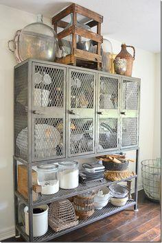 Metal lockers on top of a custom built metal frame/shelf.