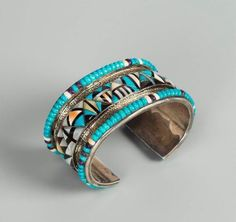 Zuni Cuff | Designer ? Silver, turquoise, jet and shell.  Channel inlay, two turquoise bands with central geometric band in turquoise, jet, and shell, with beaded edge