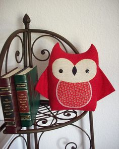 owl pillow next to books