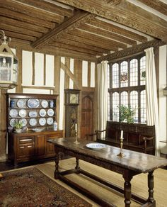 The half-timbered hall at Paycockes, with finely carved ceiling and wooden furniture