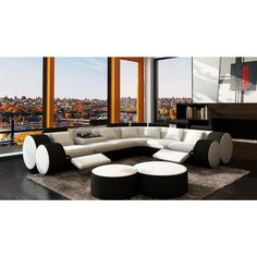 """Divani Casa 3087 - Modern White and Black Bonded Leather Sectional Sofa & Coffee Table. Dimensions: Overall: W121"""" x D100"""" x H30""""  3 - Seater: W72"""" x D39"""" x H30""""  2 - Seater: W51"""" x D39"""" x H30""""   Corner: W49"""" x D49"""" x H30""""  Seat Depth: 24""""  Seat Height: 18"""" Color: Other Finish:   - Modern ContemporaryRound Shape DesignUpholstered in bonded leather where your body touchesElegant left and right reclinersAdjustable Logged shaped head restTwo beautiful coffee tables includedThrow pillows…"""