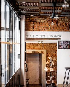 walls were knocked down to create one big venue with sections from the five former linked houses being turned into playrooms, bathrooms, conference room, wine shop and deli, bar, restaurant, kitchen and storage. the process revealed numerous different eras of clay bricks and building methods. we kept most of it exposed and planned the rest of the interior design to work with it. Restaurant Kitchen, Playrooms, Deli, Bricks, Bathrooms, Conference Room, Walls, Clay, Houses