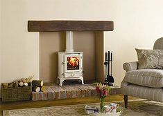 An outstanding range of wood burning stoves & fires from the UK's largest stove and fireplace producer. Wood burning, multi-fuel, Gas and Electric models available. Log Burner Fireplace, Wood Burner, Fireplace Mantels, Fireplaces, Fireplace Ideas, Wood Mantle, Cosy Fireplace, Inglenook Fireplace, Simple Fireplace