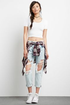 A pair of low-rise boyfriend jeans featuring a destroyed design, five-pocket construction-$32.90