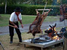 Lamb grilled cook on stake over a fire, Argentine style. Argentina. www.selectlatinamerica.co.uk