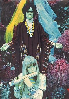 Circa Fall 1967 - Jenny Boyd playing flute in Donovan's Pre-Raphaelite style infrared photo shoot for his album, Wear Your Love Like Heaven, at Bodiam Castle, East Sussex, by Karl Ferris who was his and Jimi Hendrix's personal photographer.