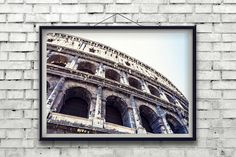 The dramatic and historic Roman Colosseum as seen from below. Bold colors make this well known attraction look like a piece of abstract art.   TITLE: Upward Arches LOCATION: Rome, Italy MEDIUM: Fine art print (unframed) PRINT SIZES: 8x10, 11x14, 12x18, 16x20, 16x24, 20x30, 24x36, 30x45 ORIENTATION: Horizontal   DETAILS All photos are photographed by me and printed in a professional, private lab. All pictures will be printed on high-quality lustre photo paper (lustre coating provides…