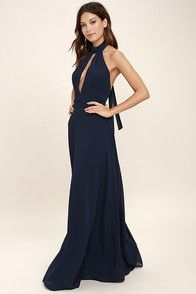 You'll always end up picking the Sway My Options Navy Blue Velvet Maxi Dress! Luxurious, crushed velvet, in a stunning navy blue shade, shapes a high halter neckline with two snap closures and a strappy, elasticized open back. Princess seamed bodice tops a maxi skirt with two sexy side slits. Hidden back zipper/clasp.