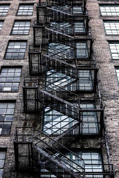 Brick building with fire escape. Stair Steps, Stair Railing, Industrial Architecture, Architecture Details, Fire Escape, Window View, Rear Window, Stairway To Heaven, Industrial Revolution