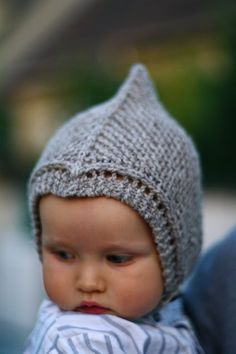 Little gnome hat. Looks like an elf helmet to me! Wonder if I could convert the pattern from knitting to crocheting?