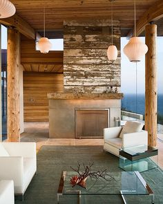 Love the distressed wood look of this fireplace | Dani Ridge House by Carver and Schicketanz | HomeDSGN