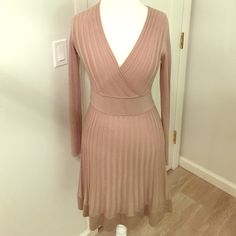 Calvin Klein Sweater Dress Pre-Owned; great condition. Beautiful tan long sleeve fitted sweater dress by Calvin Klein. 100% Acrylic. Size Small. Calvin Klein Dresses Long Sleeve