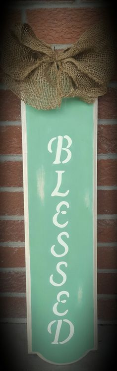 This lovely wooden sign will be a perfect addition to a blessed home. The wood is shabby chic painted with turqoise paint. It is 25 inches tall and 5 inches wide. There is a twine hanger for easy hanging and a burlap bow on top. If you wish to customize with other colors, no problem. Simply message me with you personal color choices with your order. Thank you