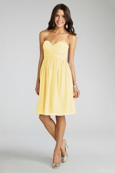 A Lemon sweetheart neckline and flirty  skirt  flatter  everyone that  wears this  delicate  chiffon.