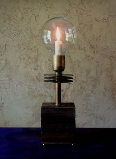 The 'flame' of the electric candle occilates inside the glass globe to a dramtic effect.