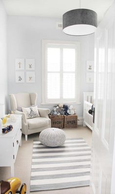 Grey and white nursery with pops of yellow