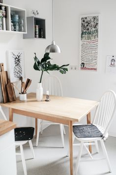to keep a room warm and slightly organic, have several wooden elements. in here, it would be the table, wooden kitchen utensils, and the wooden countertop