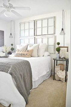 LizMarie blog white with grey and neutrals, old windows, sconce lights: