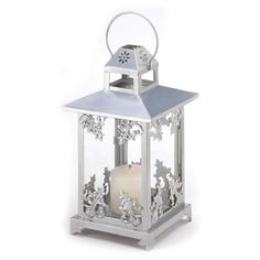 Gleaming silver finish and graceful scrollwork lend old-fashioned opulence to a classic candle lantern. An elegant decoration to enjoy, night and day! Also make