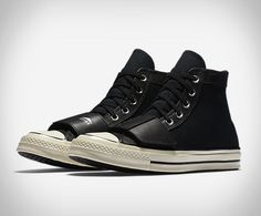 In collaboration with Tokyo's Neighborhood, Converse have created yet another variation of the iconic Chuck Taylor, a badass motorcycle riding sneaker with a foot shifter strap overlay.  Chucks, being made only from thin canvas, don't hold up to