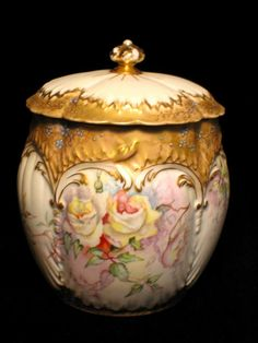 This beautiful hand painted biscuit jar was created by the Martial Redon Company of Limoges, France, a forerunner of  Porcelaine Limousine (PL Limoges) Company. The bottom has underglaze mark 2, which dates it 1891-1896.