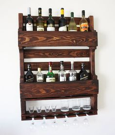This wine rack from wood mounted to the wall from reclaimed wood would look amazing in a cigar bar or next to your alcohol collection at home or