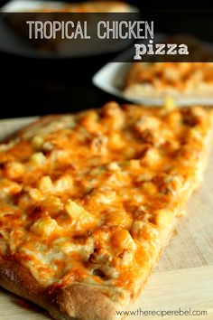 Tropical Chicken Pizza -- Alfredo sauce, pineapple, spicy chicken and lots of cheese! www.thereciperebel.com