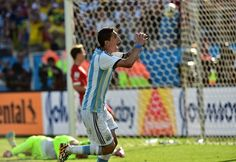 FIFA World Cup 2014 - Argentina 1 Suiza 0 (7.1.2014) - El Nuevo Herald Argentina's midfielder Angel Di Maria celebrates after scoring the 1-0 during a Round of 16 football match between Argentina and Switzerland at Corinthians Arena in Sao Paulo during the 2014 FIFA World Cup on July 1, 2014. NELSON ALMEIDA / AFP/Getty Images
