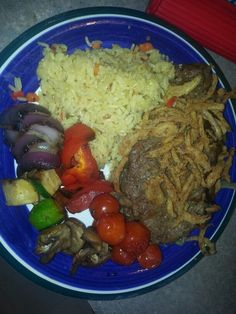 NY strip steak with braised beer onion & crunchy onion with rice pilaf and grilled veggies