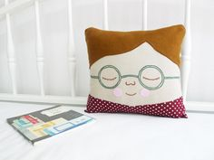 I like that this isn't a specifically gendered pillow person.  Very cute.