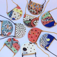Ruby Pilven ceramics At first I though those were cute little bags. Would be a great idea. Porcelain Jewelry, Ceramic Jewelry, Ceramic Beads, Ceramic Clay, Clay Beads, Ceramic Pottery, Fine Porcelain, Ruby Jewelry, Enamel Jewelry