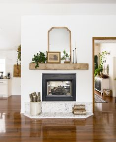 How to Install a Floating Barn Beam Mantel Do you want to add character to your home? Learn how we easily installed a floating barn beam mantel over our gas firepl. Rustic Mantel, Rustic Fireplaces, Farmhouse Fireplace, Diy Fireplace, Fireplace Decorations, Fireplace Design, Modern Fireplace Mantels, Brick Fireplaces, Modern Rustic Decor
