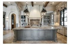 Love everything about this kitchen!! Paint grade cabinets, rock wall, ceiling, lighting. Everything!!