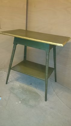 Console table in Olive Chalkpaint™ egde enhanced with 'gold leaf' all finished with Annie Sloan clear wax.