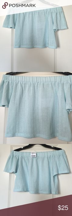 NWT urban outfitters off shoulder crop top NWT urban outfitters off the shoulder crop top in light blue, never worn. Super cute, no problems. Very soft fabric that looks knitted/detailed fabric Urban Outfitters Tops Crop Tops