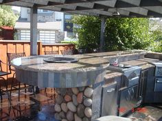 Outdoor Kitchens And Bars   ... outdoor kitchen island complete with fire table bar counter bar caddy