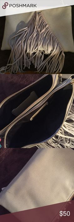Grey Fringe Clutch Also doubles as a Crossbody and comes with long strap. One small marking on the back which was there when I received it from the store. Should have taken it back! Otherwise super cute and perfect condition! Street Level Bags Crossbody Bags