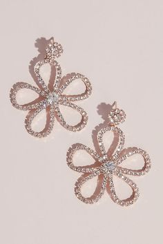 Channel boho inspiration when you wear these flower earrings. Crystals outline the design of five petals, all meeting at a large center stone. Metal, Glass 2 L x W Imported Tiny Gold Hoop Earrings, Bow Earrings, Flower Earrings, Crystal Earrings, Crystal Jewelry, Fashion Earrings, Flower Stud, Diamond Earrings, Channel Earrings
