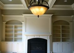Fireplace with built ins, coffered ceiling