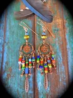 Dreamcatcher Earrings ~ Boho beaded copper earrings with Christmas beads in Copper by qisma @ Etsy