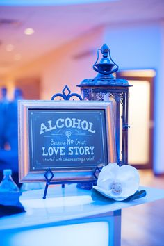 This might be the best wedding bar sign ever.