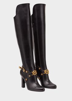 Knee-High Tribute Heeled Boots from Versace Women's Collection. High heel, knee-high boots with round pointed toe. Featuring leather strap details with gold Medusa medallion accents. Heel Boots For Women, Black Heel Boots, Black High Heels, Thigh High Boots, High Heel Boots, Over The Knee Boots, Heeled Boots, Bootie Boots, Shoe Boots