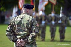 Incoming U.S. Army Garrison Rheinland-Pfalz commander Col. Keith Igyarto listens as the outgoing commander, G. Shawn Wells Jr., speaks at the garrison's change-of-command ceremony n Kaiserslautern, Germany, Wednesday, July 6, 2016. (Michael Abrams/Stars and Stripes)