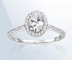 14 Karat White Gold Diamond Engagement Ring Set with 3/4 Oval Center Diamond and 32 Round Brilliant Diamonds (... $1,999.00