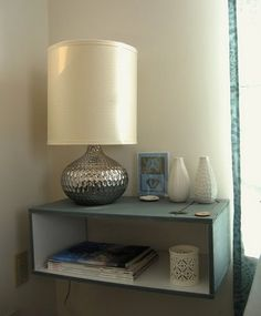 DIY Floating Nightstand. I like the contrast of the white interior color.